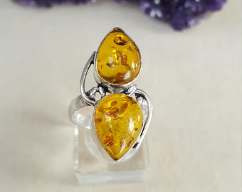 Pressed amber teardrop ring