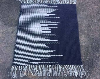 Two Striped Handwoven Rugs in One. Black and White or White and Black.