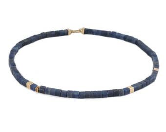 Necklace of blue cubes of sapphire with gold