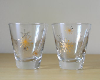 two mid century holiday snowflake lowball glasses