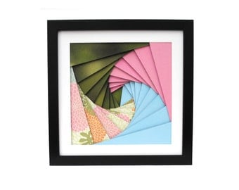 green, pink & blue colored pinwheel shadowbox- made from recycled magazines, spiral, modern, colorful, handmade, interior design