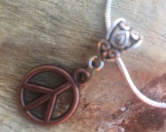 Peace necklace with silver plated snack chain 515