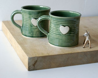 Set of two heart mugs glazed in forest green - hand thrown stoneware pottery