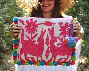 Pink clutch with pompoms and hand embroidered tassels