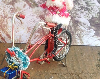 Christmas decorated red bicycle with vintage Santa, wreath, Christmas present. Mantel decor Holiday decoration Christmas decor Holiday decor