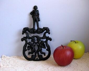 Vintage cast iron cupids trivet Cast iron pot rest