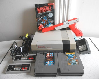 Nintendo Console with Cords, Cables. A Zapper Gun, Controllers and 5 Games/New 72 Pin Connection/Tested & Works