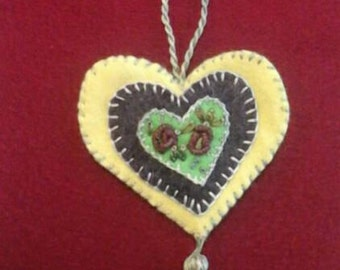 Embroidered floral wool felt heart ornament yellow, bright green and deep purple with bright green backing