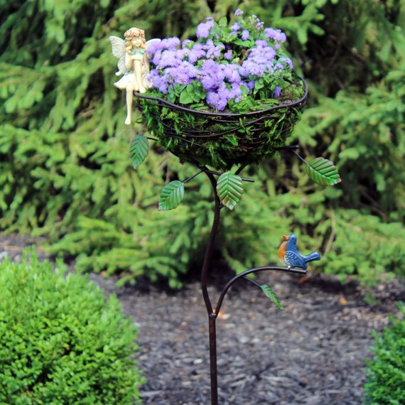 Wire Planter w/Fairy (Resin),  Metal Blue Bird and Green Leaves (Planter 50.5″ Tall |  Basket: 9.75″ Diameter |  4.75″ Planting Depth)