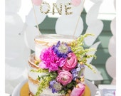 Single piece cake decoration for Jett - Purple, pink, white green