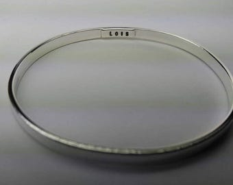 IMMORTAL LOVE. 5x2mm  bangle bracelet with ashes solder-sealed behind personalized name plate in 1mm deep cavity. Made to order. 925 silver