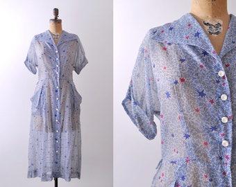 1950's pocket dress. large. 50 star print dress. blue. buttons. collar.