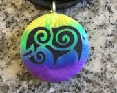 Tribal Elephant hand carved on a polymer clay multi color background. Pendant comes with a FREE necklace