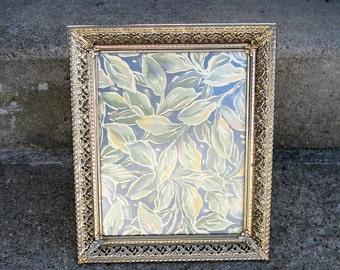 "gold metal frame filligree embossed metal 7 "" by 9 ""  easel back hollywood regency feminine"