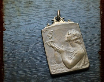 Antique Medal of the French Family with a woman holding trophy - Vintage Award Art Nouveau bronze pendant