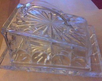 A stunning vintage cut glass butter or cheese dish.
