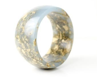 dove grey round bangle made with eco resin containing metallic gold leaf foil