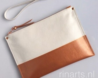 Leather wristlet / Clutch / zipper pouch in white full grain leather; the bottom part is hand painted in a metallic copper color
