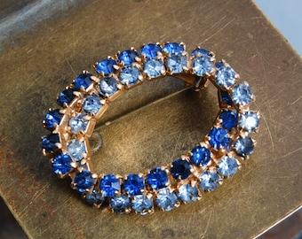 Vintage round brooch metal, with blue glass rhinestones
