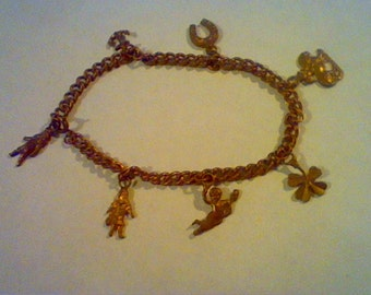 Vintage Victorian lucky charm brass bracelet Buster Brown Mary Jane Cherub on lion 4 leaf clover anchor horseshoe