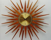 RESERVED for KATIE Starburst Clock by Seth Thomas, Mid Century Modern 1970s Starflower Sunburst Wall Clock, Teak Rays.