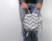 small backpack purse. gray chevron with purple accents. interior pockets and key ring clip. ready to and on sale for Christmas.