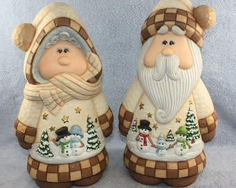 Old Fashion Santa and Mrs Claus set hand painted in a rustic brown and ivory to give it a wooden look with a winter snowman scene