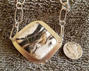 White buffalo turquoise pendant in sterling silver.
