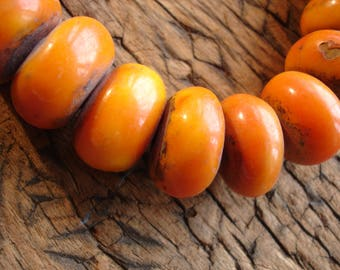 Medium  Moroccan  dark  orangey tarnished amber resin bead