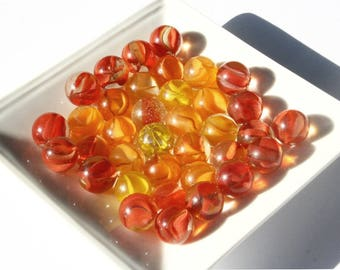 Vintage marbles, orange cat's eye, 35 orange and yellow glass marbles