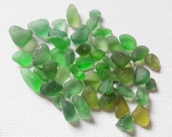 Little pretty pile of green sea glass chips and tinies -  English sea glass.