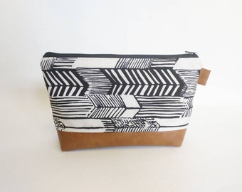 Black and white arrow print makeup bag with brown faux leather