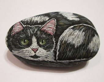 Black and White hand painted on a stone - pet rock - by Ann Kelly