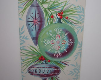Colorful 1950's-60's christmas card woth mid century glass ornaments hanging from tree limb pinks, greens, blues