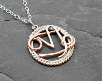Cancer Capricorn necklace sterling silver and copper with beaded edging