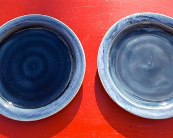 Two small Blue green Ceramic Plates Marked BT on the back Very Deep High Gloss Glaze