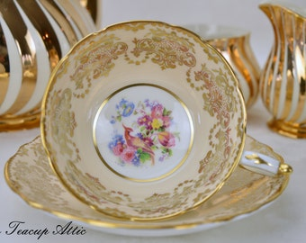 ON SALE Paragon Pale Peach Teacup and Saucer With Gold Overlay Bird Of Paradise, Pattern A1047, ca. 1952-1960