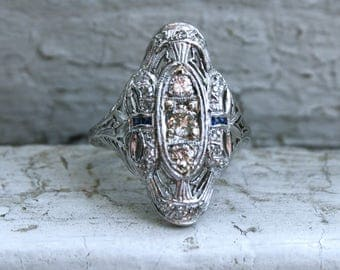 Stunning Antique Filigree Platinum Diamond and Sapphire Ring - 0.84ct.