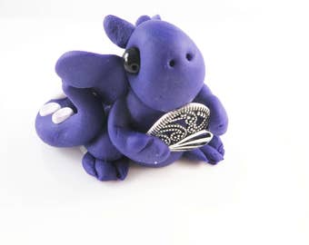 Polymer clay purple baby dragon with a heart