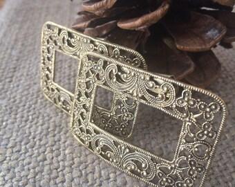 antique MUSI brass shoe clips pair