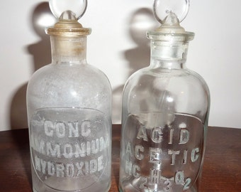 vintage chemistry set of 2 T.C.W Co.  Embossed apothecary/chemistry jars with ground glass stoppers