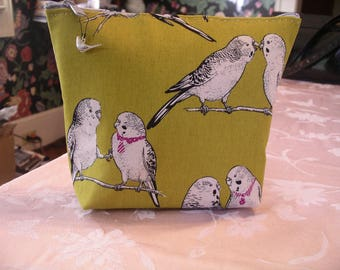 Parakeets on a gold background
