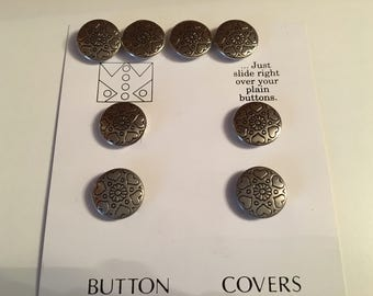 Silver colored button covers.