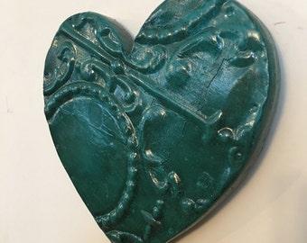 Ornate aqua heart designed with antique tin ceiling tile