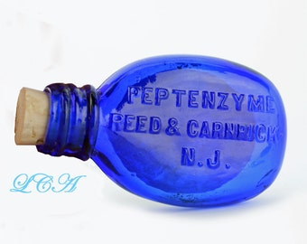 Colorful little COBALT BLUE quack medicine - pill bottle PEPTENZYME tablets 1800s - tiny oval pocket flask