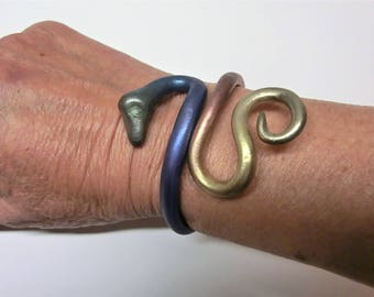 Metallic rainbow snake bracelet/ painted with metal powder/ flexible Fimo (polymer) snake around the arm/ can bend open careful