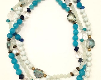 Multi-strand blue quartz necklace with crystal and lapis beads.