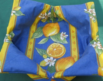 Bread basket Oilcloth, cotton coated wipeable reversible and foldable.Elegance and convenience. French fabric from Provence, big lemons.