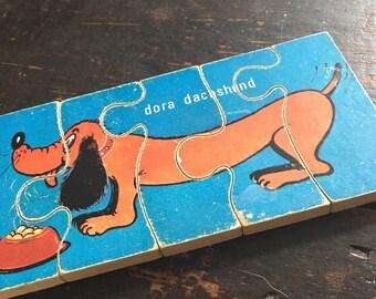 Childrens 1960's vintage wooden jigsaw puzzle Dora Daschund