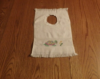 Counted cross stitched turtle baby bib